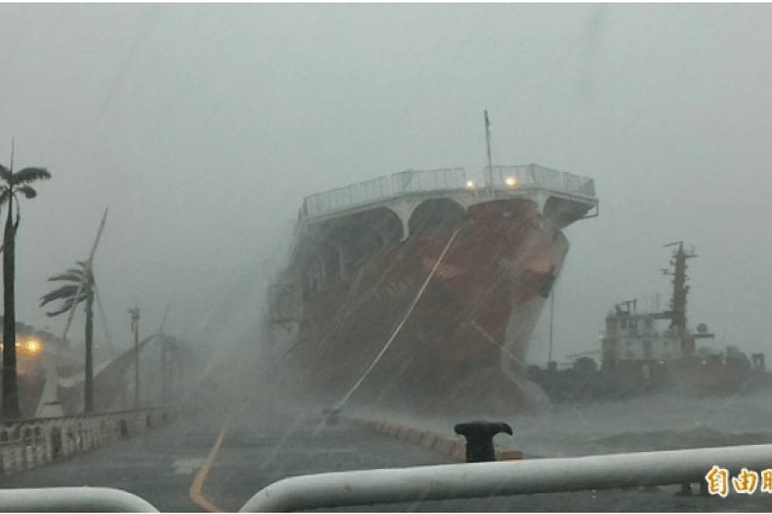 Singapore-registered cargo vessel Avata caught in a storm in Kaohshiung port on July 8, 2016.