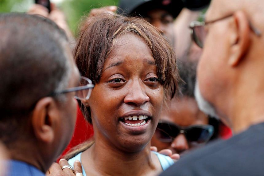 "Diamond Reynolds weeps after she recounts the incidents that led to the fatal shooting of her boyfriend Philando Castile by Minneapolis area police during a traffic stop on Wednesday, at a ""Black Lives Matter"" demonstration in front of the Governor's"
