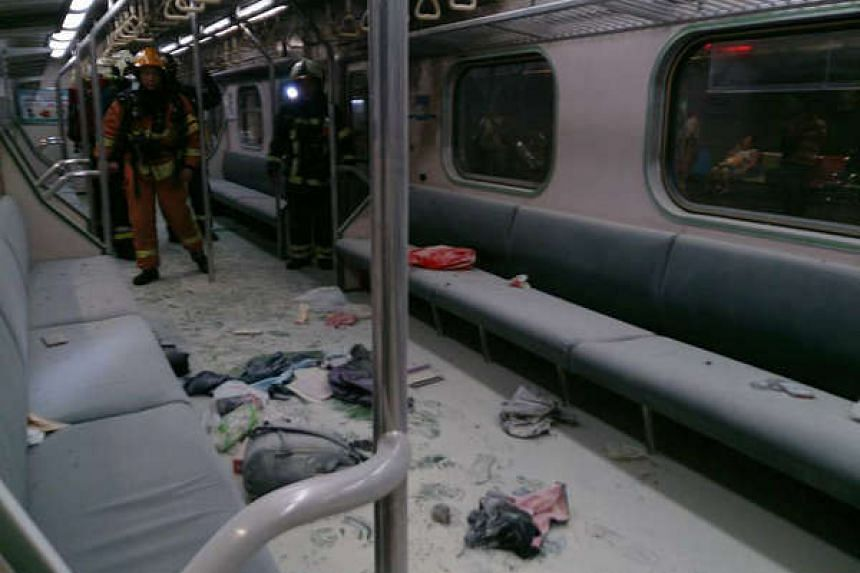 Debris covers the floor of a train after an explosion, near Taiwan's Songshan station, on July 7, 2016.