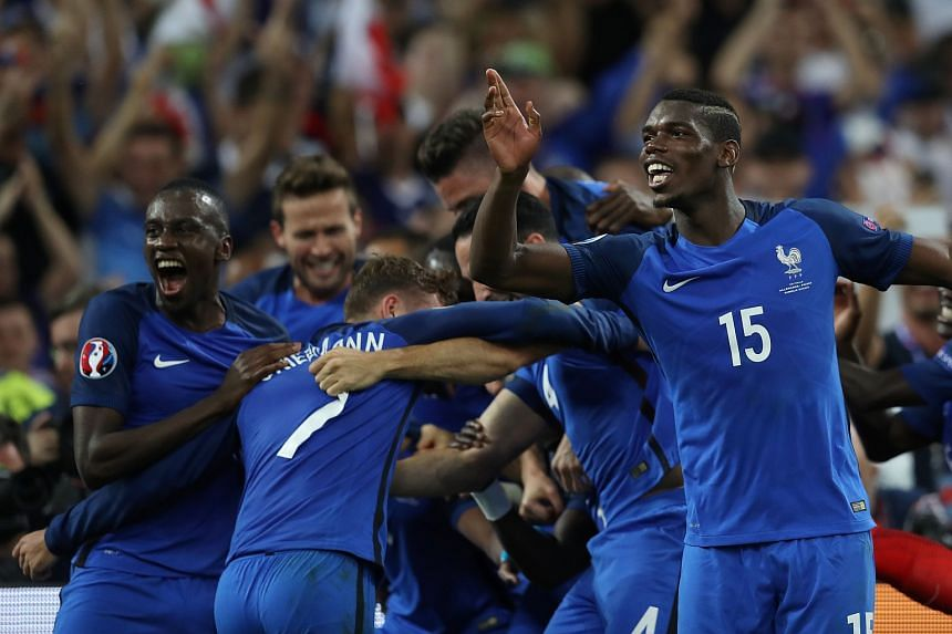 The French team celebrate after winning the Euro 2016 semi-final football match between Germany and France at the Stade Velodrome in Marseille on July 7.