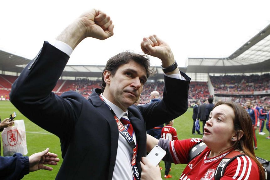 Middlesbrough manager Aitor Karanka celebrates with fans after being promoted to the Barclays Premier League.