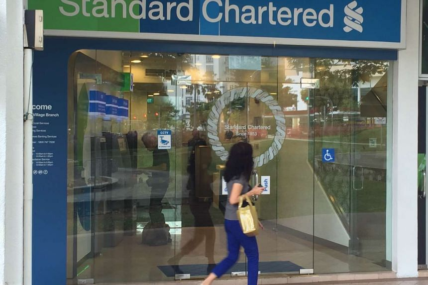 Business is as usual at the Standard Chartered bank Holland Village branch on Friday (July 8), a day after the robbery.