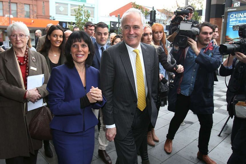 Australian Prime Minister Malcolm Turnbull (centre) and Liberal candidate for the federal seat of Chisholm Julia Banks (second from left) on a street walk in Oakleigh, Victoria, on July 8, 2016.