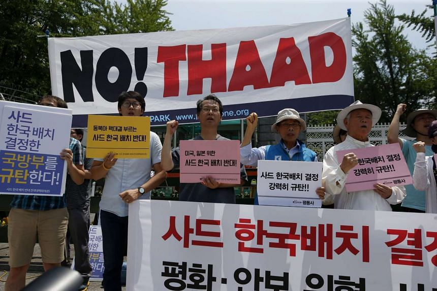 Members of progressive South Korean civic groups shout slogans to rally against the national defence policy in Seoul, on July 8, 2016.