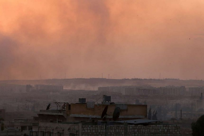 Smoke rises after airstrikes on Aleppo's Castello Road, the rebels' sole supply route to the city.