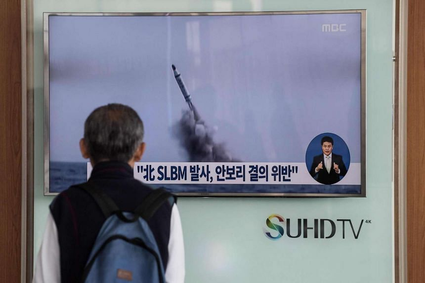 A man watches a television news channel in Seoul showing footage of a North Korean missile launch on April 24.