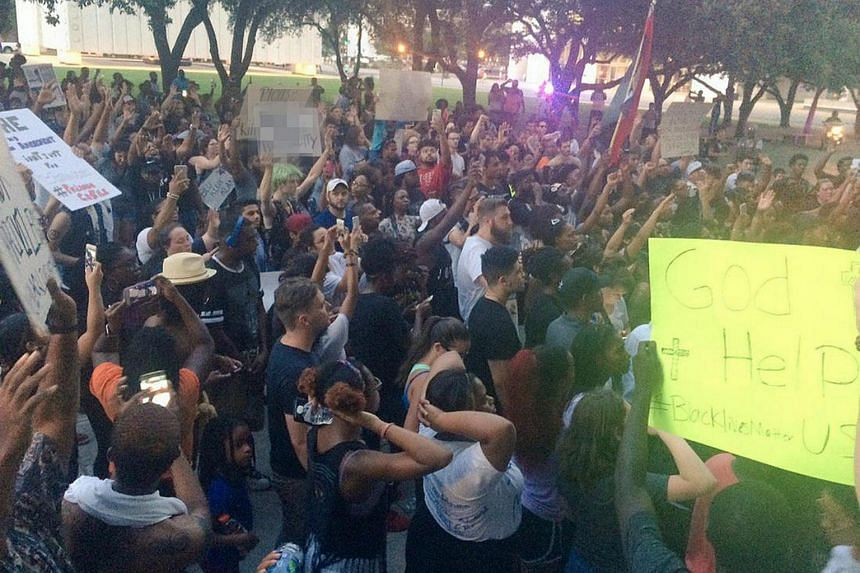 Marchers protest against police shootings of two black men in Louisiana and Minnesota during a demonstration in Dallas, Texas, US, on July 7.