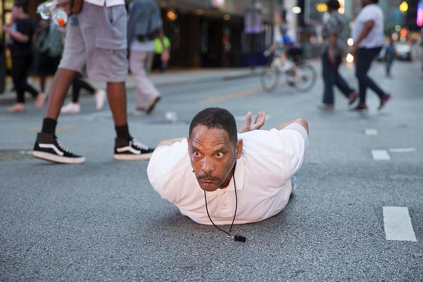 """A man lays on the ground after yelling """"Don't shoot me"""" at police during a rally in Dallas, Texas July 7 to protest the deaths of Alton Sterling and Philando Castile."""