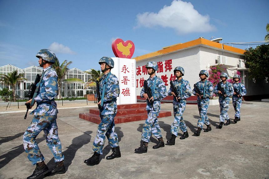 Soldiers of China's People's Liberation Army Navy patrol at Fiery Cross Reef, in the Spratly Islands, known in China as the Nansha Islands, on February 9.
