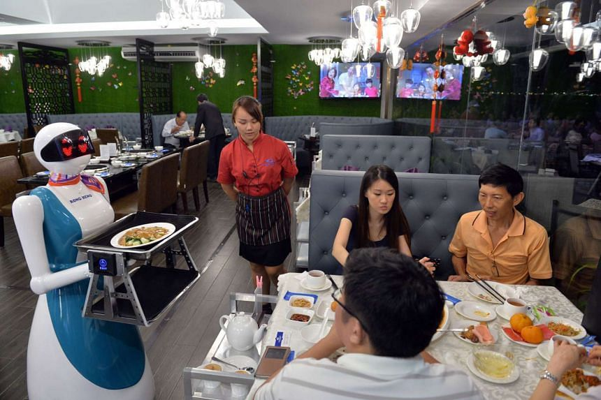 A robot delivering food at Rong Heng Seafood restaurant. The ILO noted Singapore's efforts to use technology to deal with the skills shortage and rising labour costs.
