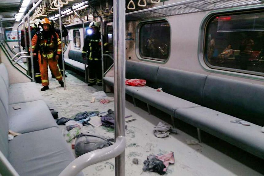 At least 21 people were injured when a section of the commuter train moving nearby Songshan Railway Station exploded and burst into flames on July 7.