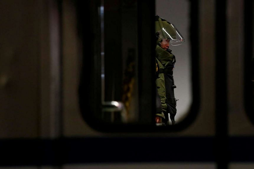 A bomb disposal expert checks a train after an explosion at the Songshan train station in Taipei, Taiwan, on July 7.