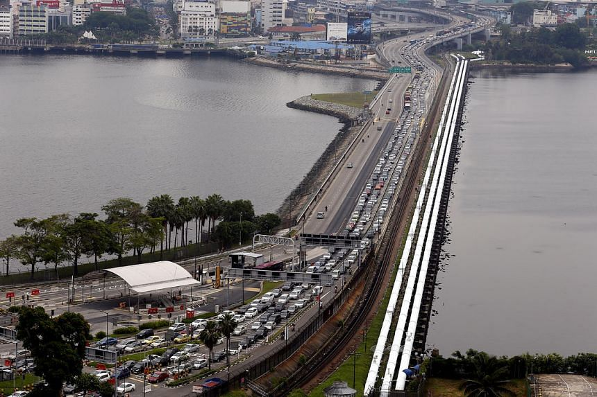 Vehicles travelling on the Causeway between Singapore and Johor Baru.