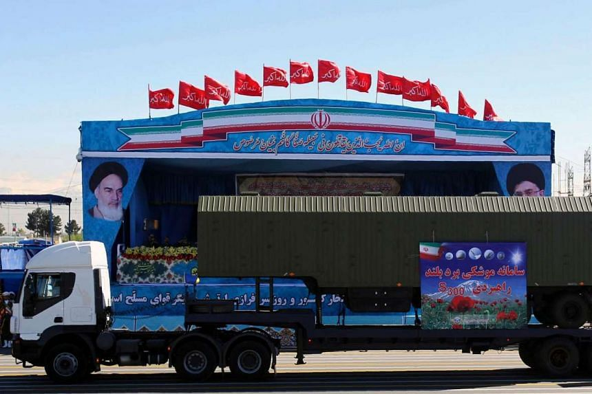 An Iranian military truck carries parts of the S300 missile system at the Army Day parade in Teheran, on April 17, 2015.