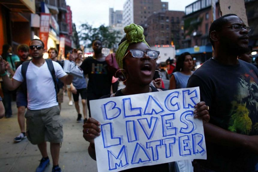 People take part in a protest against the Dallas police shootings in New York City.