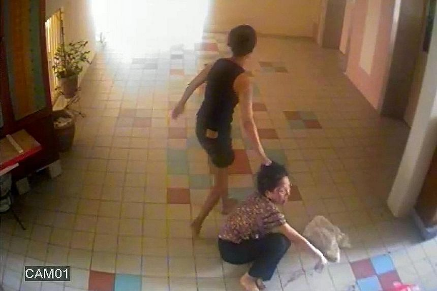 Ng (far right) was caught on video assaulting Madam Toh (above). She rained punches on the elderly woman and dragged her by the hair across the floor, among other things.