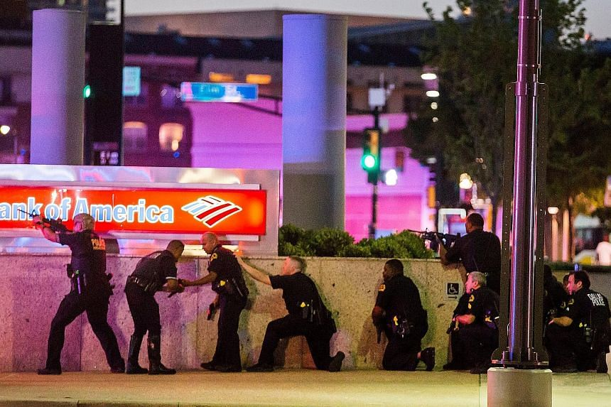 "It was dusk on Thursday, during a peaceful protest involving around 800 people, when the shots suddenly came ""out of nowhere"", leaving five Dallas police officers dead and two civilians injured in downtown Dallas, Texas."