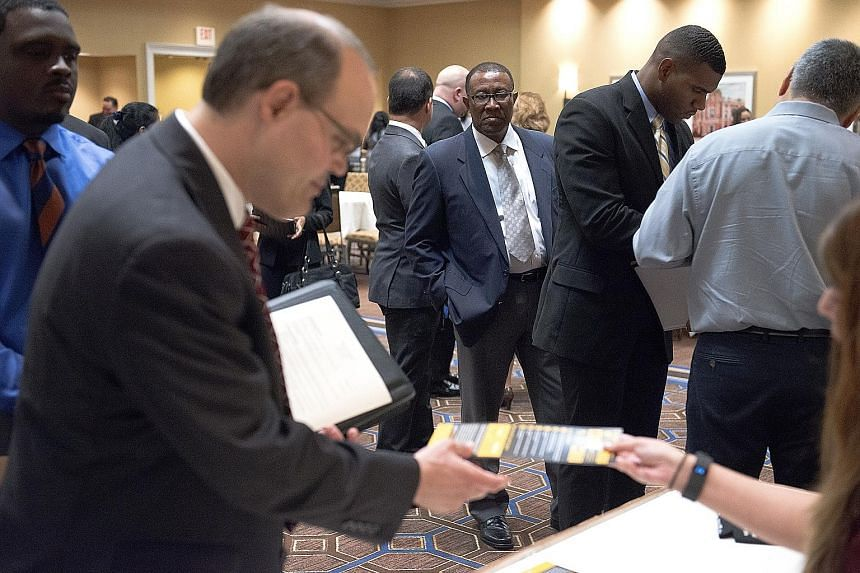 Job seekers at a career fair in Houston, Texas, on Thursday. The US leisure and hospitality sector added 59,000 jobs, registering the biggest gain since February last year. But, overall, wages advanced less than projected.