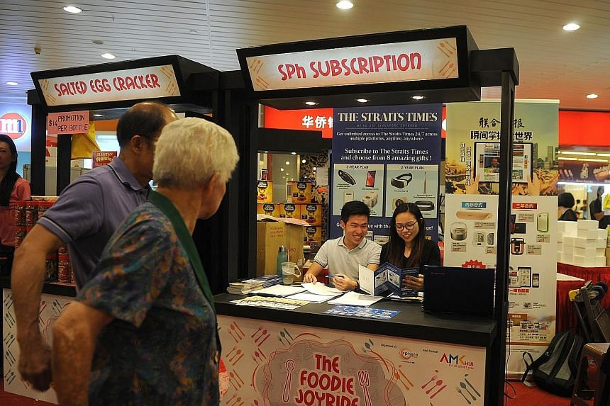SPH subscription booths set up islandwide offer attractive deals and prizes for ST subscribers.