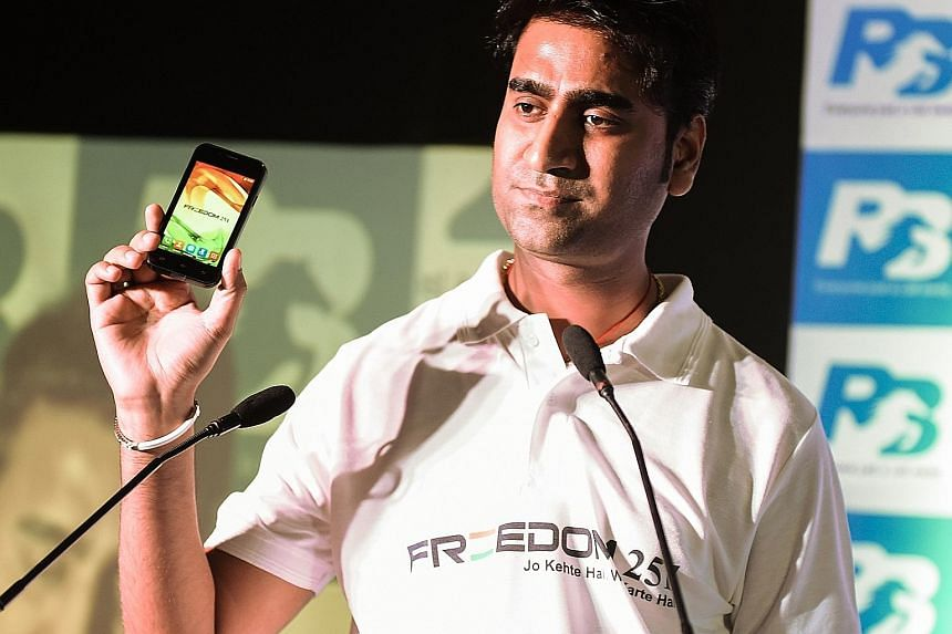 Ringing Bells' Mr Goel with the Freedom 251 at a media event in New Delhi on Thursday.