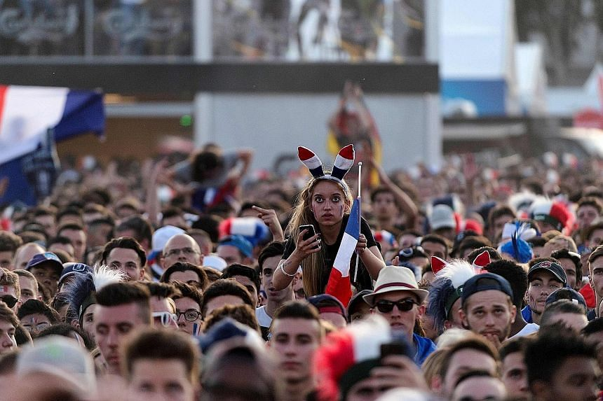Fans in Lyon watching host nation France put world champions Germany to the sword.