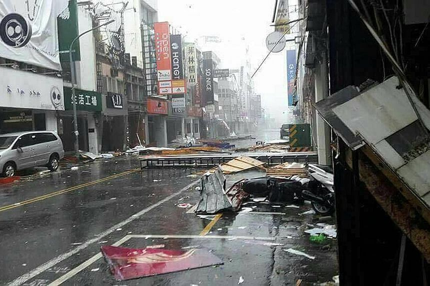 Several Singaporeans in Taiwan have been forced to change their travel plans as the super typhoon made landfall. It tore into Kaohsiung (above) and Tainan yesterday, and is expected to hit China today.