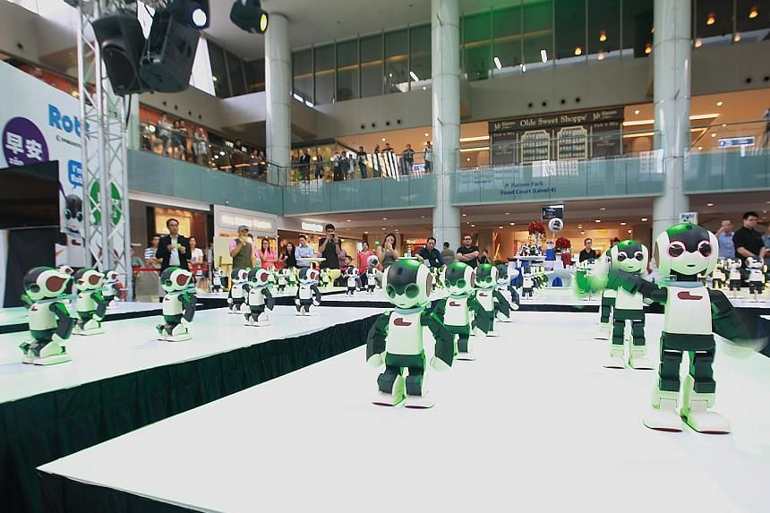 At the launch of the Singapore version of Robi at Marina Square yesterday, a hundred of the robots performed a short dance routine. The robot is hugely popular because it can walk and move fluidly and has an endearing personality.