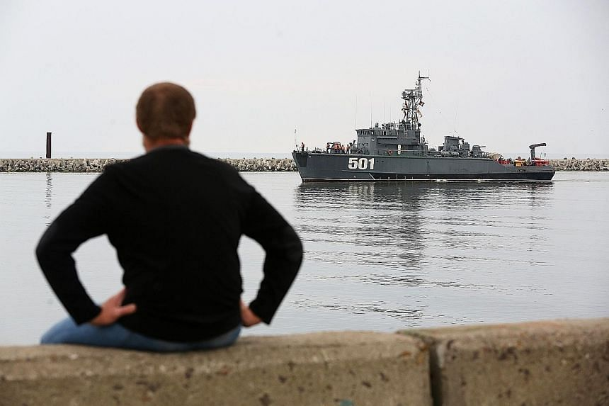 A Sonya-class Russian navy minesweeper sailing past a harbour wall in the Vistula lagoon in Baltiysk, Kaliningrad, recently. Amid Russia's recent rearmament, the Kaliningrad region has increasingly returned to its Soviet-era role as a garrison on the