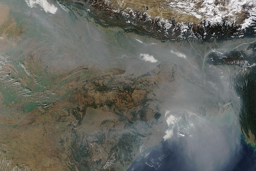 A Nasa satellite image showing a thick blanket of haze hovering over the Indo-Gangetic Plain on Jan 3, darkening skies over northern India and Bangladesh.
