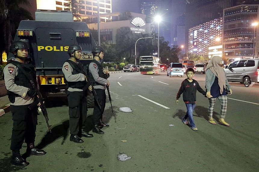 Indonesian police officers boosting security in Jakarta on Tuesday, the last day of the holy month of Ramadan, after a suicide bomb attack in Solo, Central Java. Security analysts say the bombing may be part of coordinated strikes around the world du