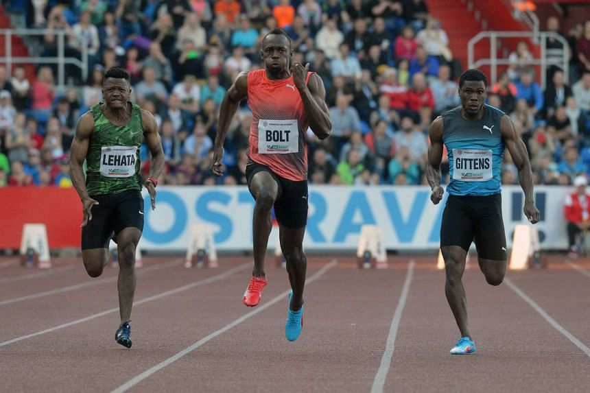 Jamaica's Usain Bolt (centre) competing in the men's 100m event at the IAAF World Challenge in May. He is due at the Rio Olympics after suffering a hamstring injury.