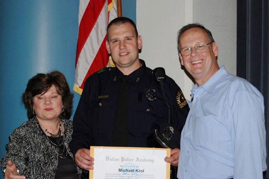 Michael Krol, a 40-year-old officer with the Dallas Police Department, seen in this family photo taken at his 2008 graduation from the Dallas Police Academy with his parents, Susan Ehlke and Frank Krol.