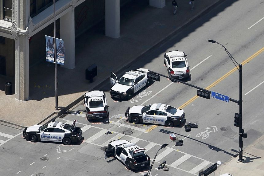 Police cars parked at the crime scene of the shooting attack in downtown Dallas, Texas.
