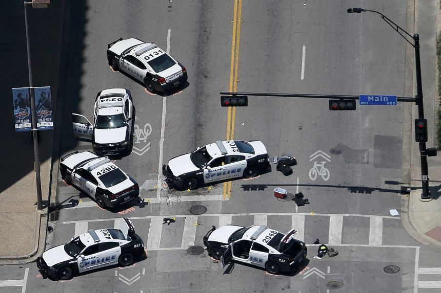 Police cars parked near the scene of the scene of the Dallas police shootings.