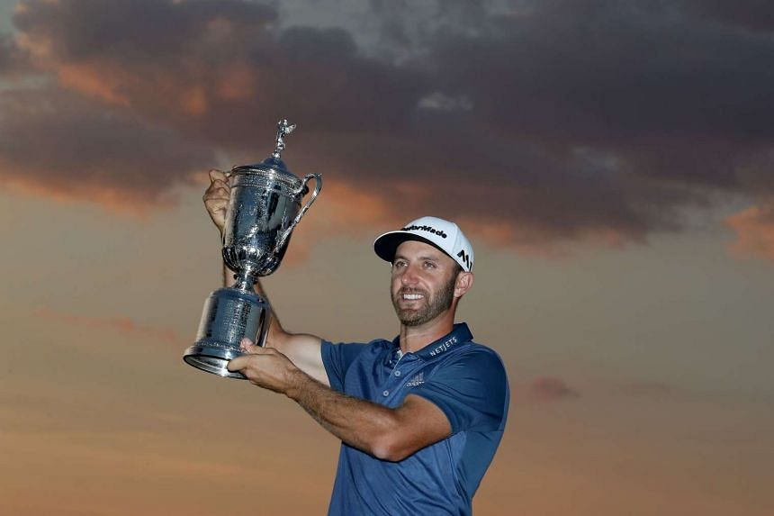 Dustin Johnson holds the trophy after the final round of the 2016 US Open, on June 19, 2016, in Oakmont, Pennsylvania.