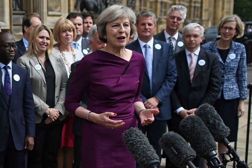 British Conservative party leadership candidate Theresa May speaks at The St Stephen's entrance to the Palace of Westminster in London, on July 7, 2016.