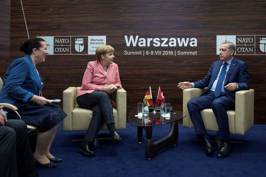 Germany's Chancellor Angela Merkel meets with Turkey's President Tayyip Erdogan at the Nato Summit in Warsaw, on July 9, 2016.