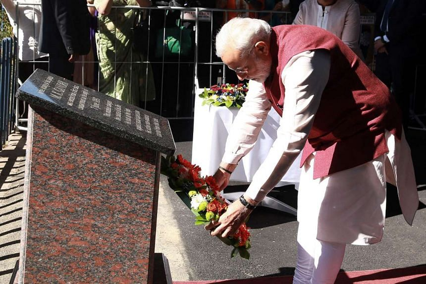 Indian Prime Minister Narendra Modi lays a wreath at the Pietermaritzburg railway station, on July 9, 2016.