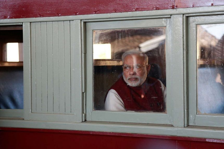 Indian Prime Minister Narendra Modi arrives by train at the railway station in Pietermaritzburg, on July 9, 2016.