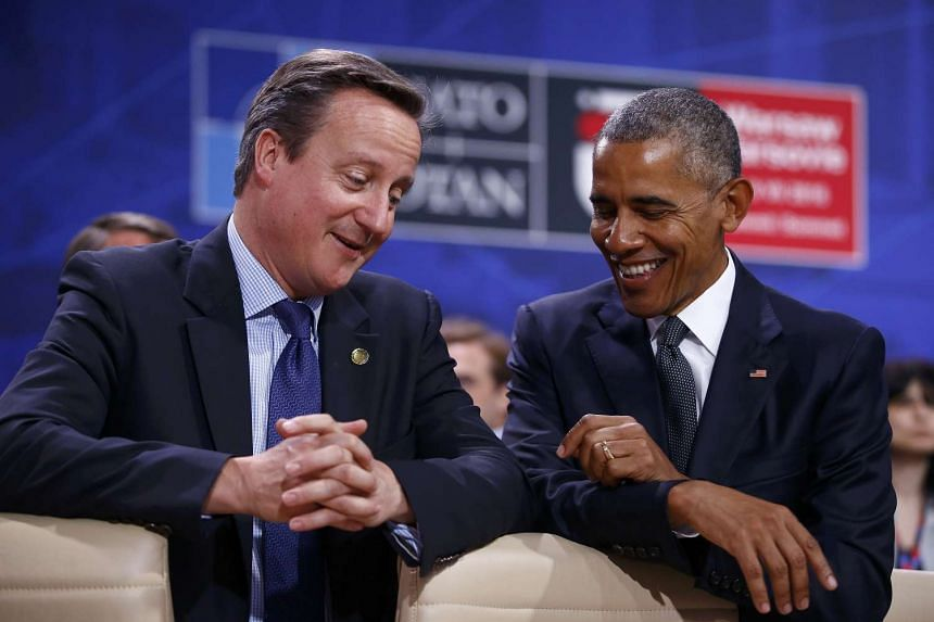 US President Barack Obama having a light-hearted moment with British Prime Minister David Cameron during the NATO Summit in Warsaw, Poland.