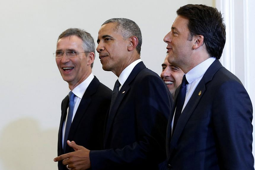US President Barack Obama (centre) with Nato secretary-general Jens Stoltenberg (left) and Italian Prime Minister Matteo Renzi at the Presidential Palace in Warsaw, Poland.