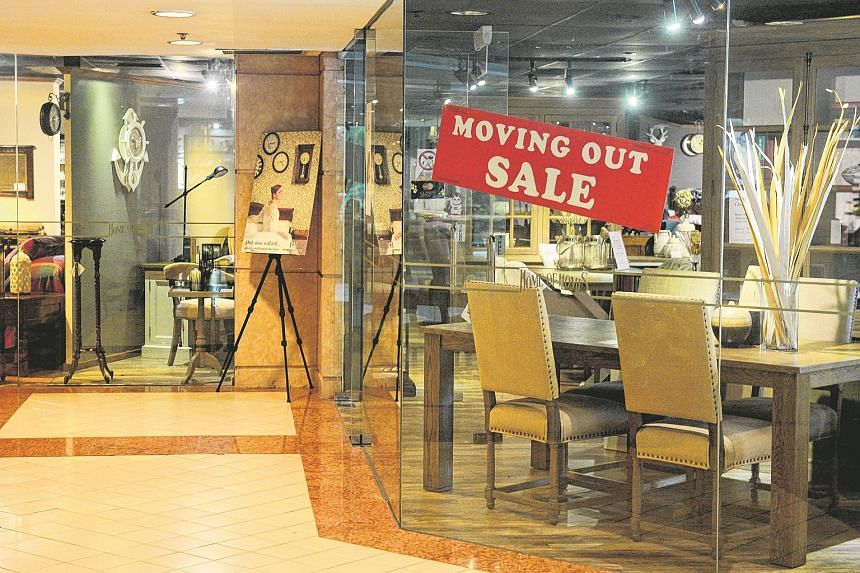 """A """"moving out sale"""" sign at one of the furniture shops in Park Mall, which will shut for good at the end of September."""