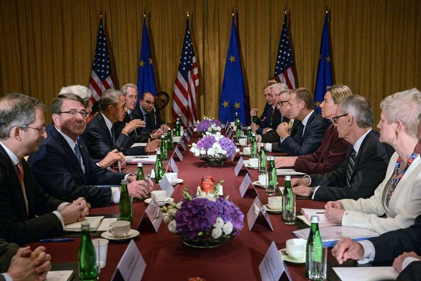 US President Barack Obama (fifth from left), European Council President Donald Tusk (fifth from right), European Commission President Jean-Claude Juncker (sixth from right) and EU High Representative for Foreign Affairs and Security Policy Federica M