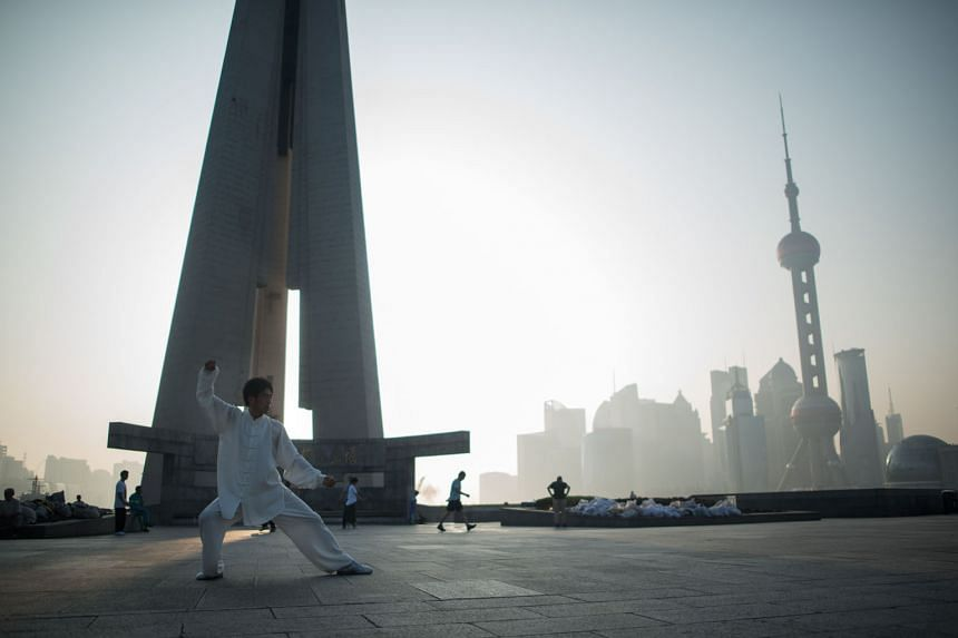 A man exercising against a backdrop of the Lujiazui financial district in Shanghai. Countries in the region recognise the power of the Chinese economy and prefer to work with Beijing despite differences in other areas of their relationships.