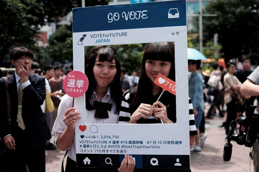 High school students in Tokyo with a cardboard Instagram frame calling on the youth to vote in tomorrow's Upper House elections. Last year, Japan lowered the voting age to 18 from 20 - the first change since 1945, when the voting age was revised to 20 fro