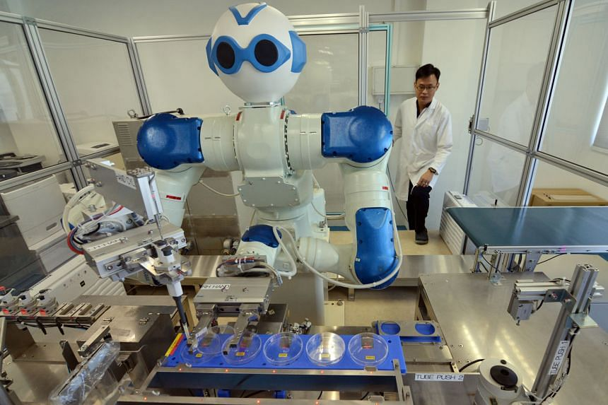 Above: Microbiological testing laboratory Ugene Laboratory Services invested in a $1.5 million robot to do routine tasks like weighing samples and to conduct simple tests for bacteria like E. coli.