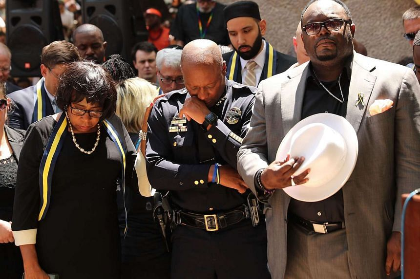 Dallas Police Chief David Brown pauses at a prayer vigil following the deaths of five police officers during a Black Live Matter march on July 8 in Dallas, Texas. This is the deadliest incident for U.S. law enforcement since September 11.