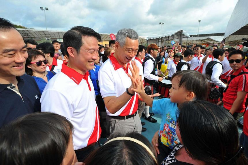 Prime Minister Lee Hsien Loong (third from left), Dr Lam Pin Min (second from left) and Dr Koh Poh Koon (extreme left) attending the Sengkang West Single Member Constituency's 10th Anniversary Carnival Celebrations on July 10, 2016.