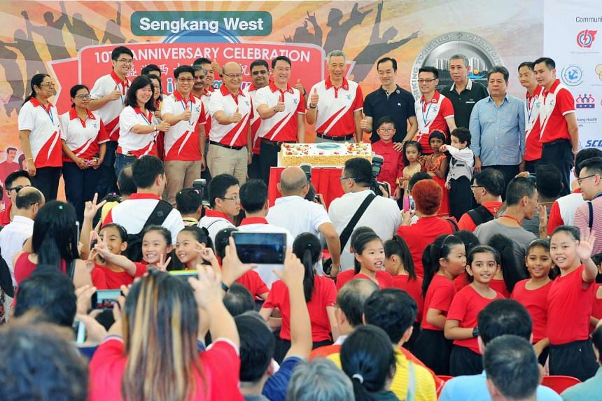 Prime Minister Lee Hsien Loong (seventh from right), Dr Lam Pin Min (fifth from left, front row) and Dr Koh Poh Koon (sixth from right) attending the Sengkang West Single Member Constituency (SMC)'s 10th Anniversary Carnival Celebrations on July 10,