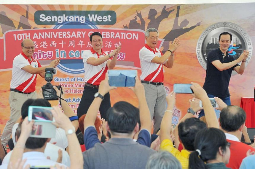 (From left) Mr Raymond Chua, Dr Lam Pin Min, Prime Minister Lee Hsien Loong and Dr Koh Poh Koon dancing at the surprise anniversary dance performance during the Sengkang West Single Member Constituency's 10th Anniversary Carnival Celebrations on July